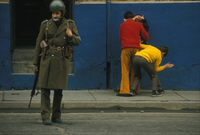 "Children mimic the arrests of ""extremists"" in the days after the coup d'etat  Santiago Sep 73"