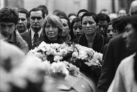 Madame Neruda and mourners gather at the cemetary.