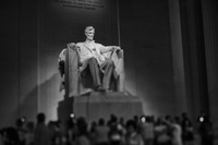 The Lincoln Memorial, a giant statue of Lincoln looks out across the Mall