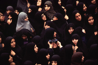 Outside Khomeini's room at the school, hundreds of chador-clad women gather to see a glimpse of the Ayatollah.