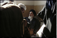 In the small school where he kept his offices after arriving in Tehran, Khomeini greets visitors.