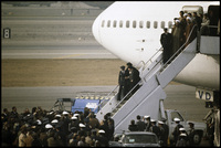 Ayatollah Khomeini arrives in Tehran on Air France, to an uncertain future.