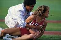 Her dreams dashed after colliding with Zola Budd, Mary Decker looks on in pain: 1984 Olympics