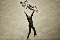 ...and winning the Gold. Tatyana Volosozhar and Maksim Trankov, Russia  ©2014 David Burnett/IOC