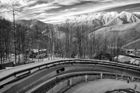 The Bobsled run and Sochi in the distance    ©2014 David Burnett/IOC
