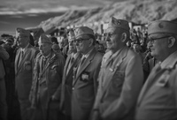 Members of the 29th Divisio gather at Dog/Red on Omaha beach, 0700, 70 years after D-Day to salute their fallen comrades