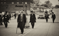 Frederick Douglass and Lincolns walk on the main street of Vandalia.