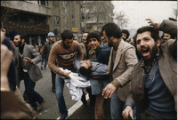 Wounded demonstrators are carried to an ambulance.