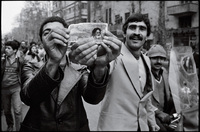 Tehran erupts in joy, with news of the Shah's departure.